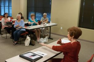Sheila Johnstone instructs American Sign Language Advanced Class.